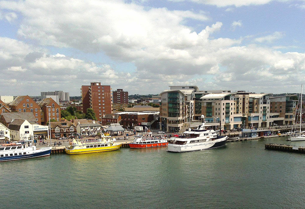 aerial photo of multiple ferries in Poole Harbour