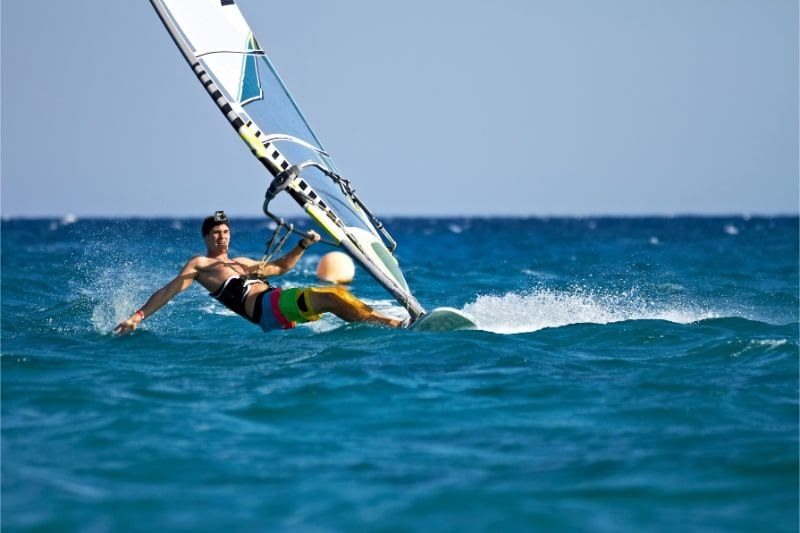 a person performing windsurfing