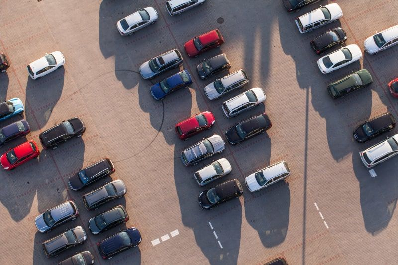 photograph of cars in a car park