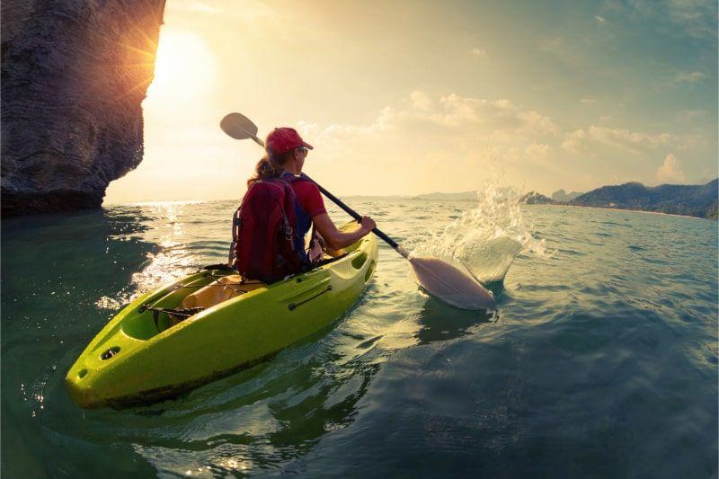 photo of a women Kayaking